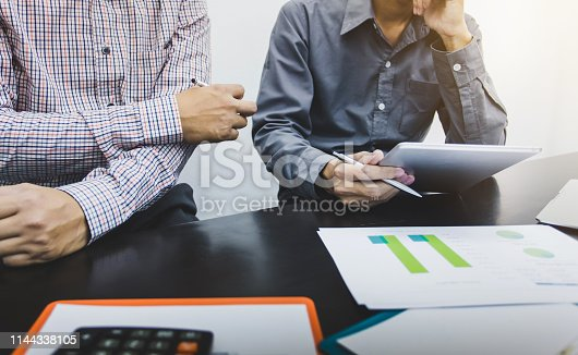 istock Business people to comment on investment and marketing plan in the meeting. 1144338105