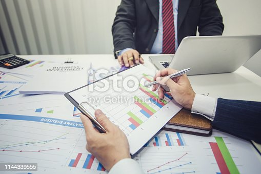 istock Business people to comment on investment and marketing plan in the meeting. 1144339555