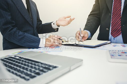 istock Business people to comment on investment and marketing plan in the meeting. 1144340881
