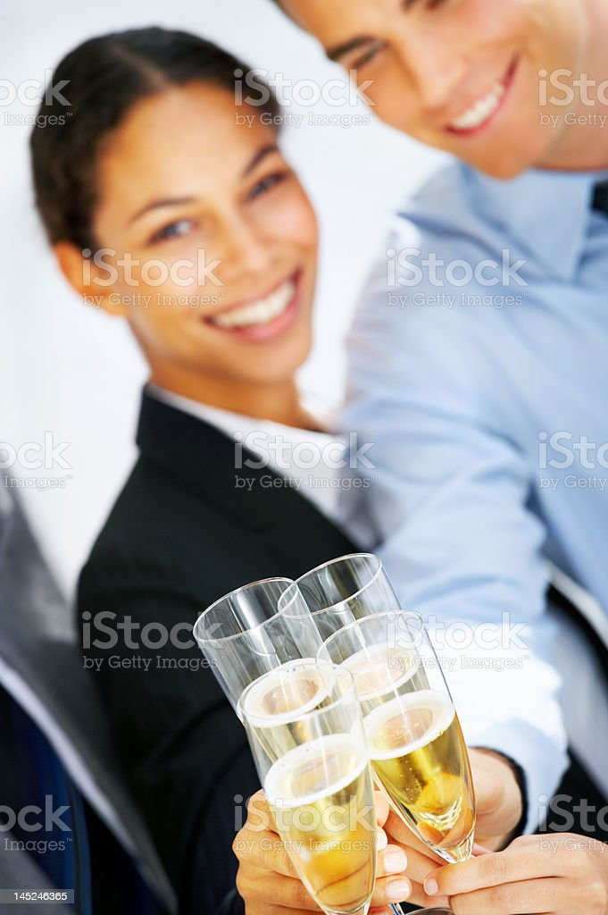 Business people toasting champagne flutes royalty-free stock photo