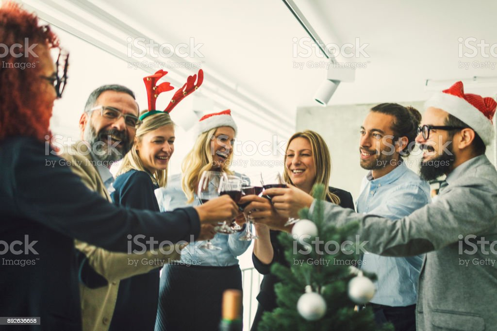 Business people toasting with red wine at workplace stock photo