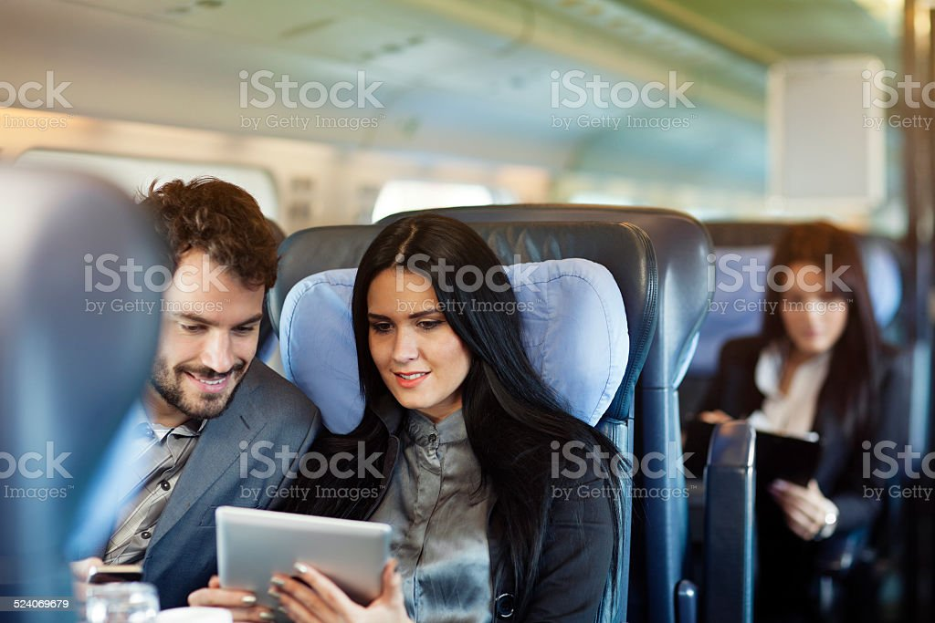 business people travel by train stock photo