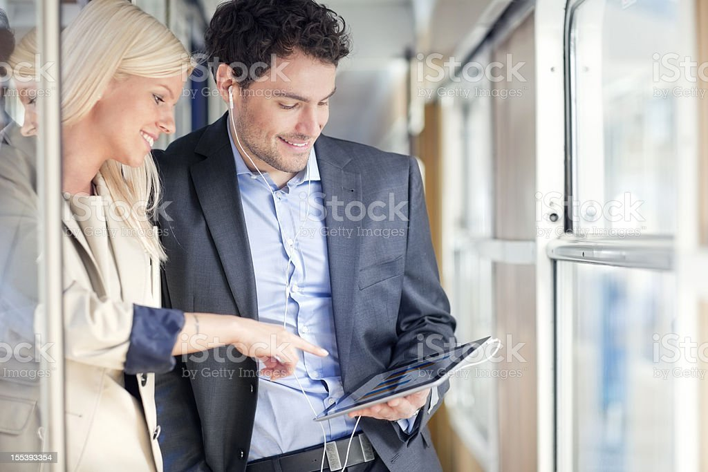 business people travelling on passenger train using digital tablet royalty-free stock photo