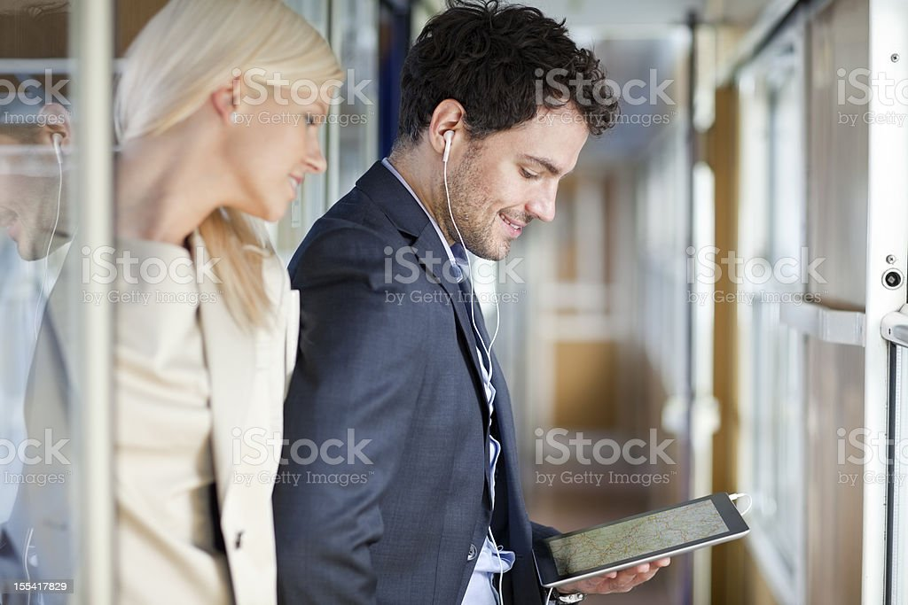 business people travelling on passenger train using digital tablet stock photo