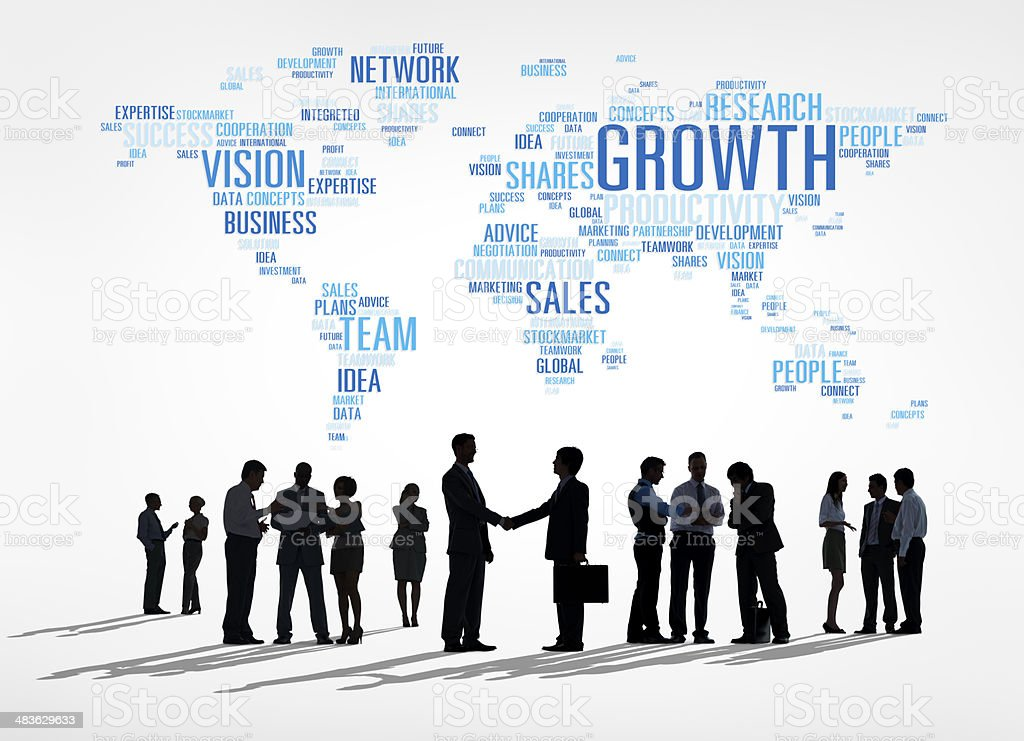 Business people under atlas made of business words stock photo