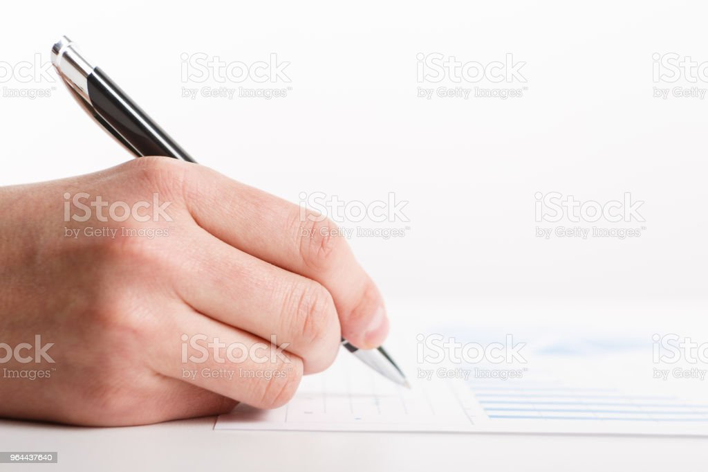 Business people use pen to point graphs to analyze company data - Royalty-free Accountancy Stock Photo