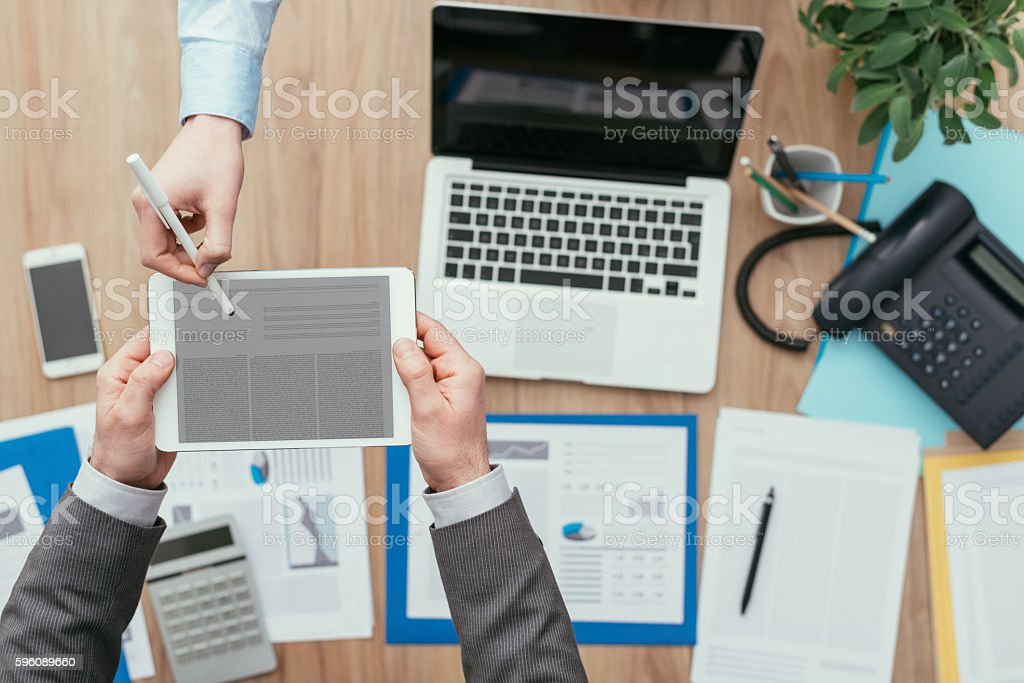 Business people using a digital tablet royalty-free stock photo