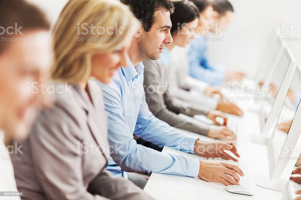 Business people using computers. stock photo