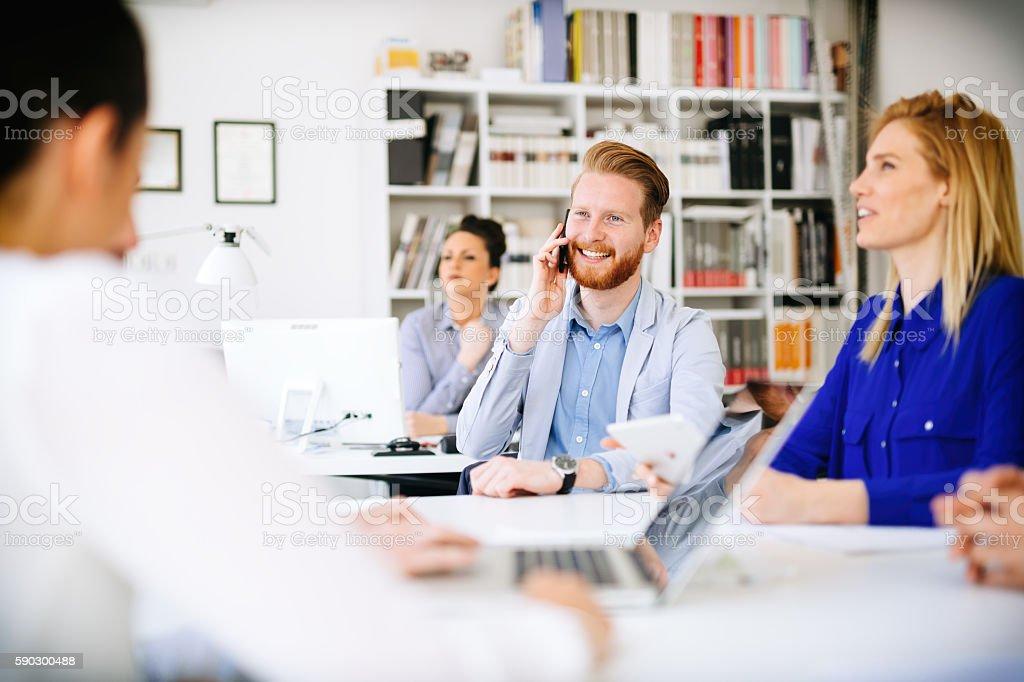 Business people using devices royaltyfri bildbanksbilder