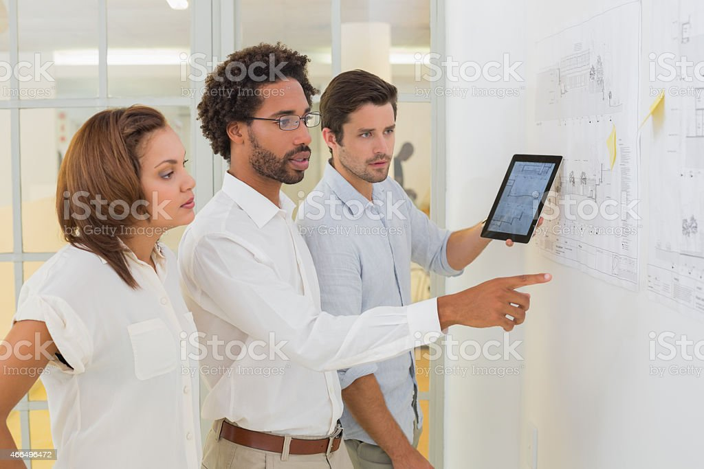 Business people using digital tablet in meeting at office stock photo