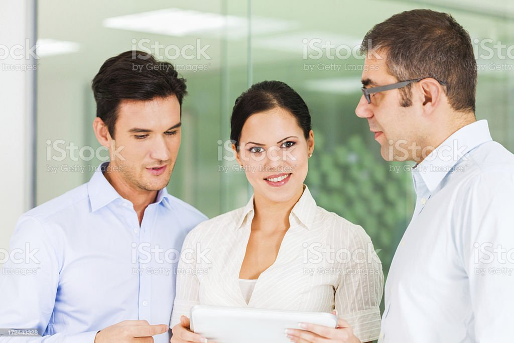Business people using digital tablet royalty-free stock photo