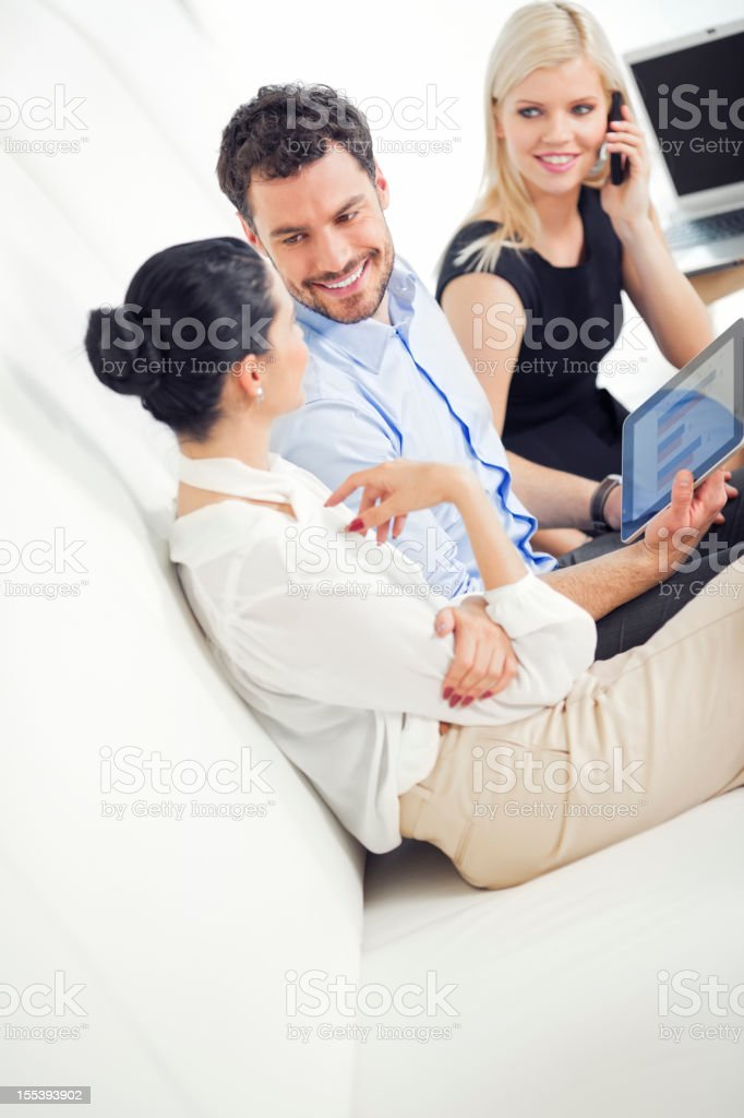 Business people using digital tablet together at the meeting royalty-free stock photo