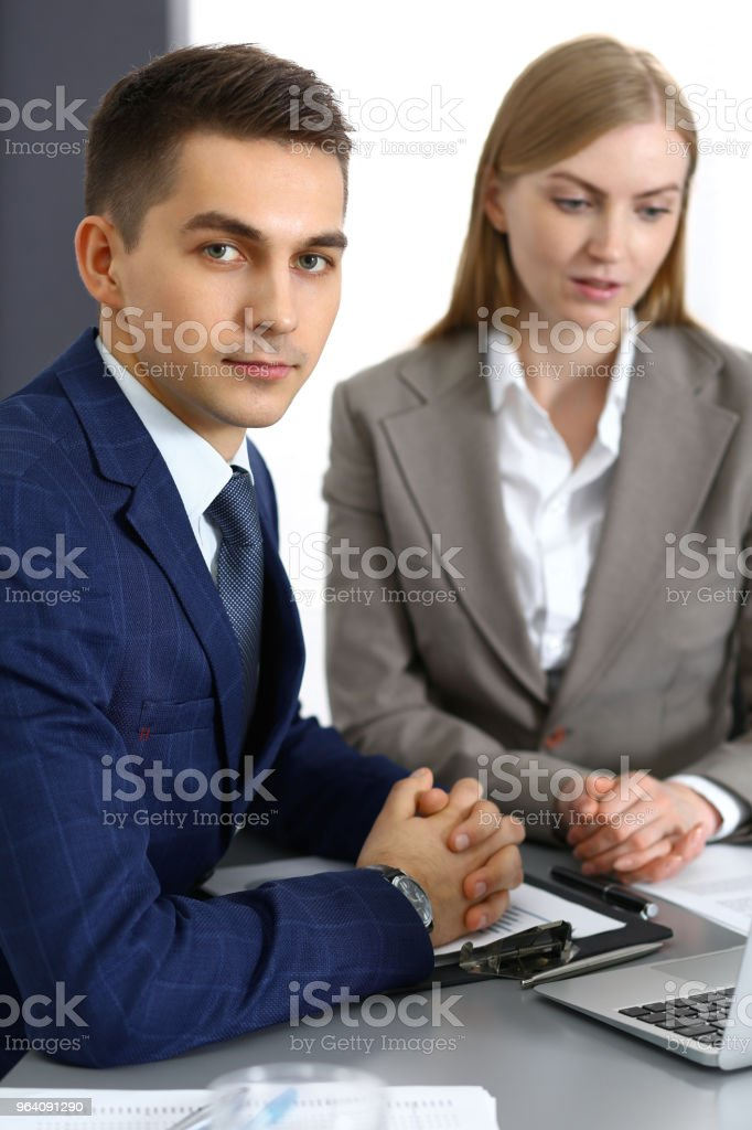 Business people using laptop pc while discussing project in office - Royalty-free Adult Stock Photo