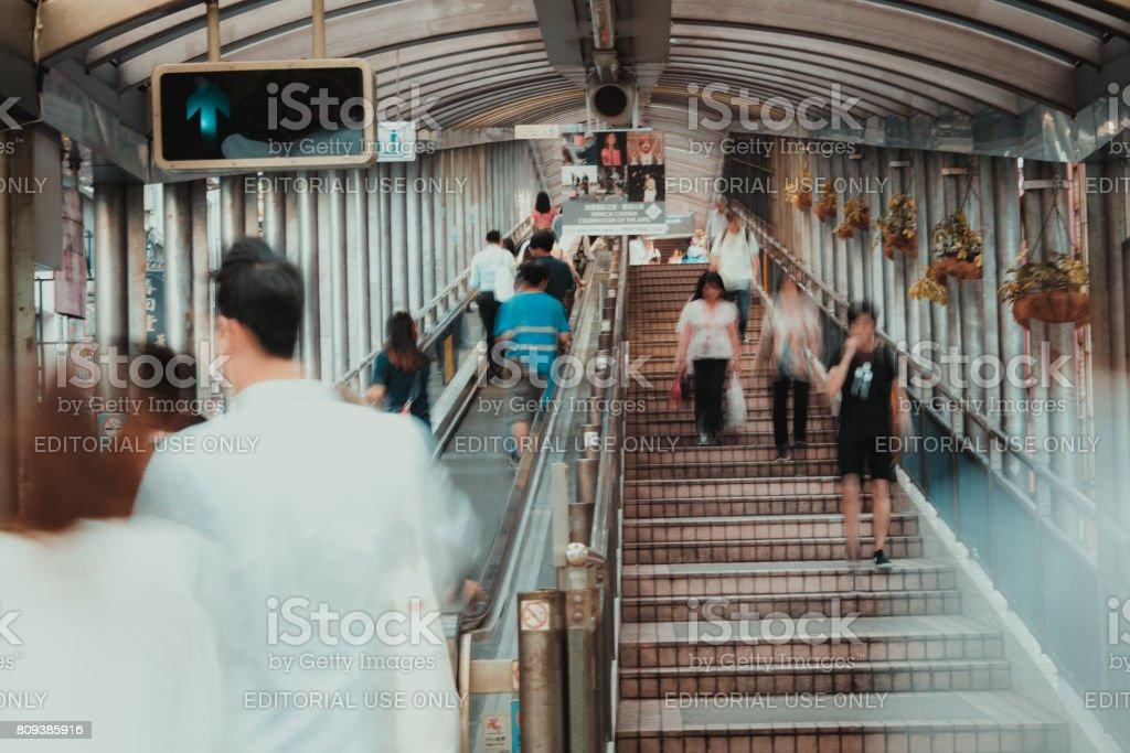 Business people using Mid-Levels Escalator Hong Kong stock photo