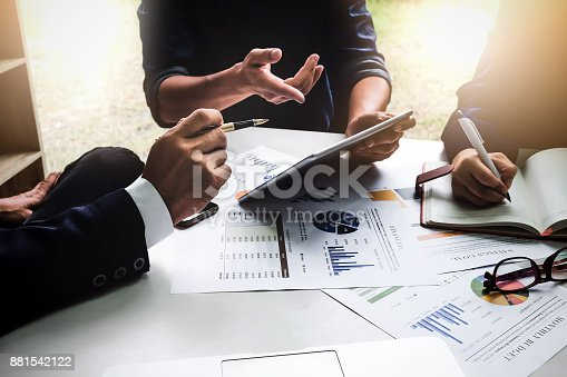 istock Business people using pen,tablet,notebook are planning a marketing plan to improve the quality of their sales in the future. 881542122