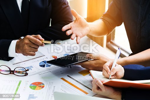 881542122istockphoto Business people using pen,tablet,notebook are planning a marketing plan to improve the quality of their sales in the future. 905778096
