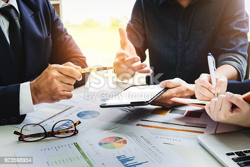 942382022istockphoto Business people using pen,tablet,notebook are planning a marketing plan to improve the quality of their sales in the future. 923568934