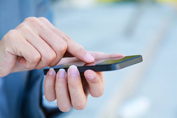 Business People Using Smart Phone stock photo