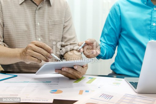 istock Business people using tablet at working with financial. 943062558