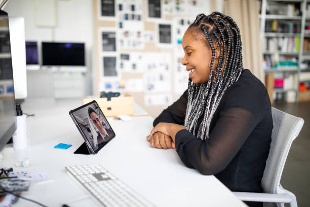 Business people video conferencing at office stock photo