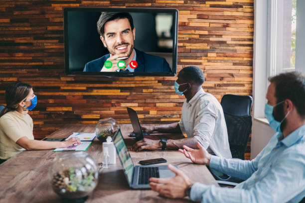Business people video conferencing during COVID-19 pandemic stock photo