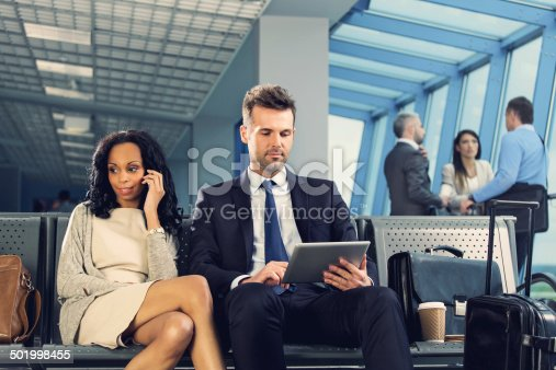 istock Business people waiting for flight 501998455