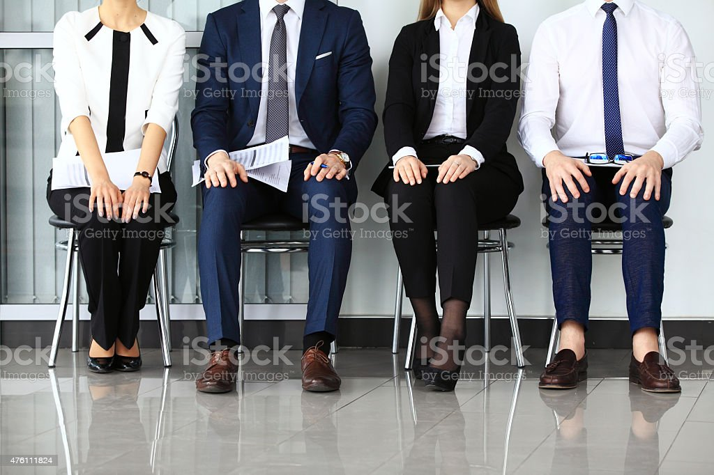 Business people waiting for job interview. Four candidates competing...