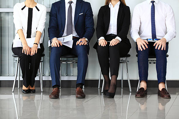 Business people waiting for job interview. Business people waiting for job interview. Four candidates competing for one position military recruit stock pictures, royalty-free photos & images