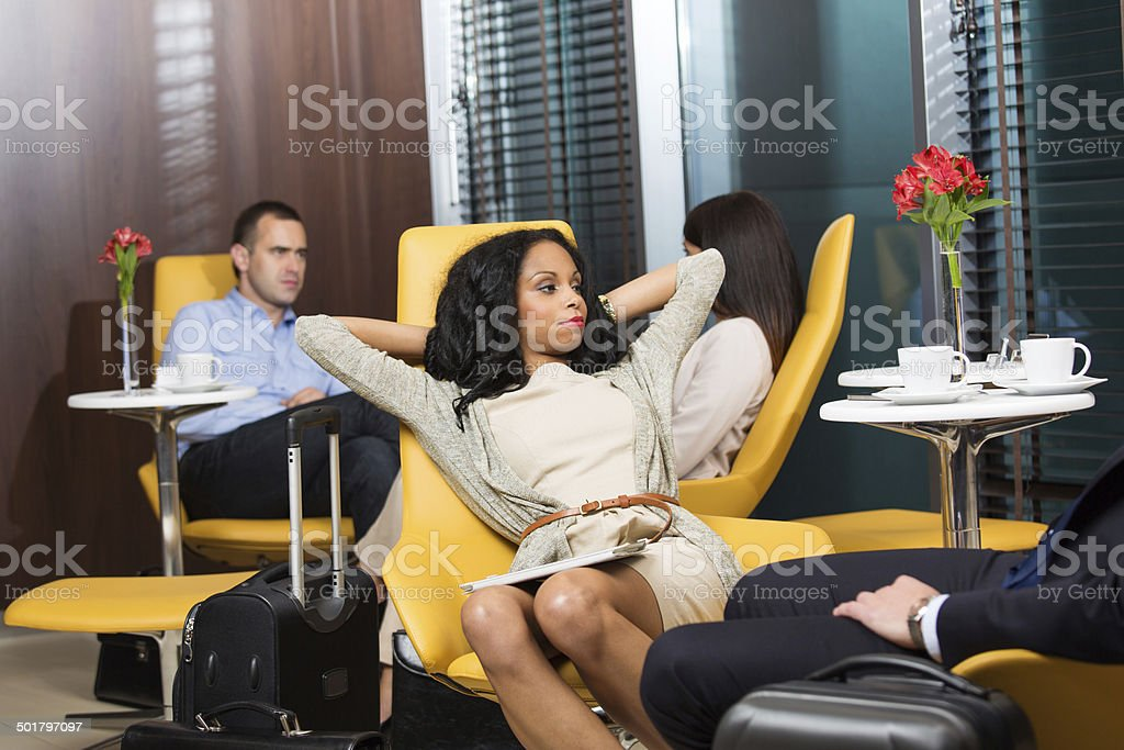 Business people waiting for the flight stock photo