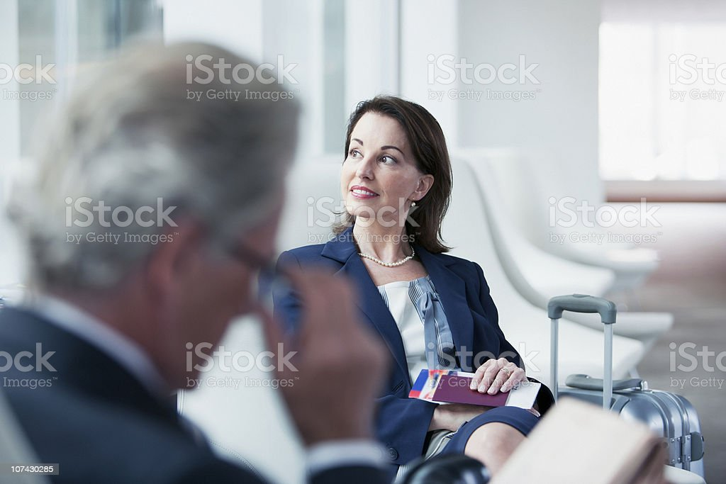 Business people waiting in airport stock photo