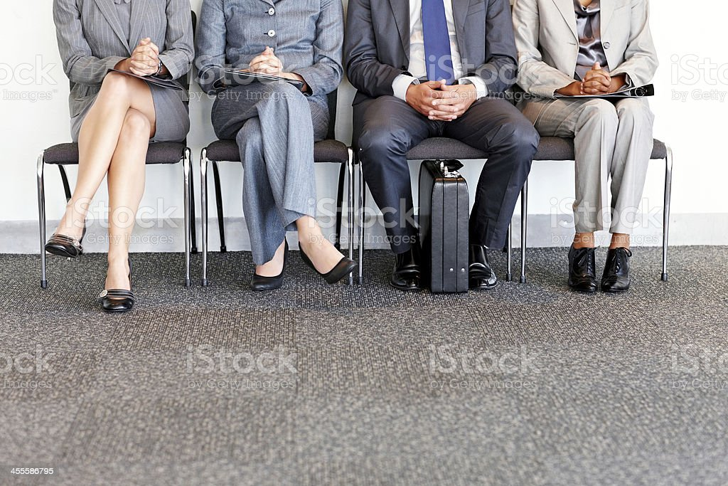 Business People Waiting in Chairs royalty-free stock photo
