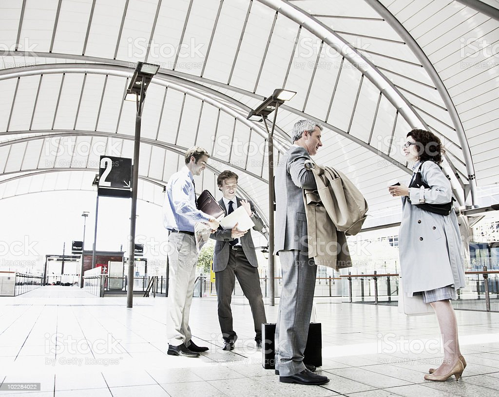 Business people waiting in train station royalty-free stock photo