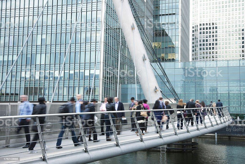 Business People Walking Across Bridge in Financial District, London, UK stock photo