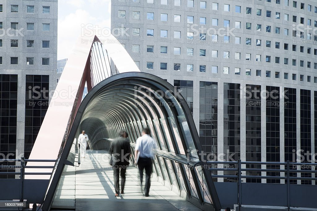 Business People Walking Along an Elevated Walkway, La Defense, Paris royalty-free stock photo