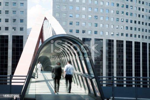 889637894 istock photo Business People Walking Along an Elevated Walkway, La Defense, Paris 183037995