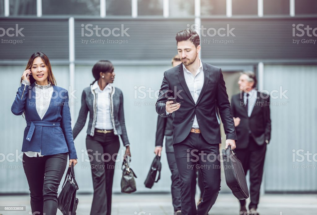 Business people walking Along The Street stock photo