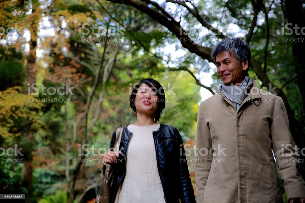 Business people walking at Sanmon area of Tofuku temple stock photo