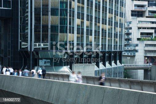 889637894 istock photo Business People Walking Down Elevated Walkway in Financial District, Paris 154002772
