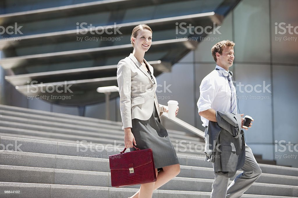 Business people walking down steps outdoors royalty-free stock photo