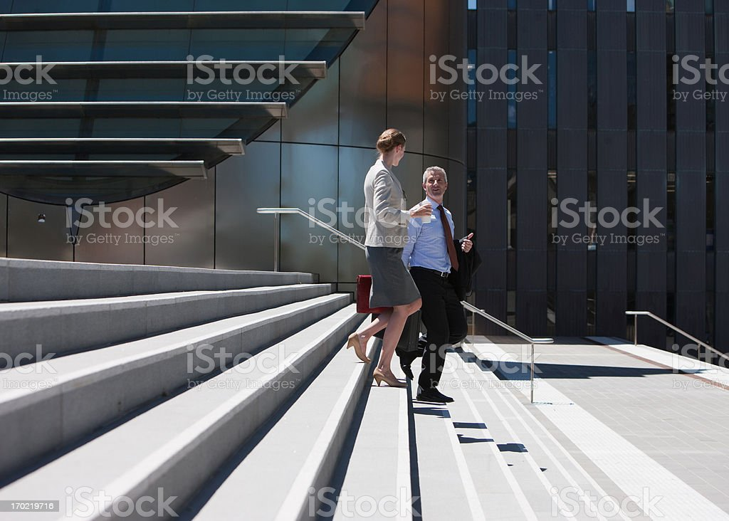 Business people walking down steps royalty-free stock photo