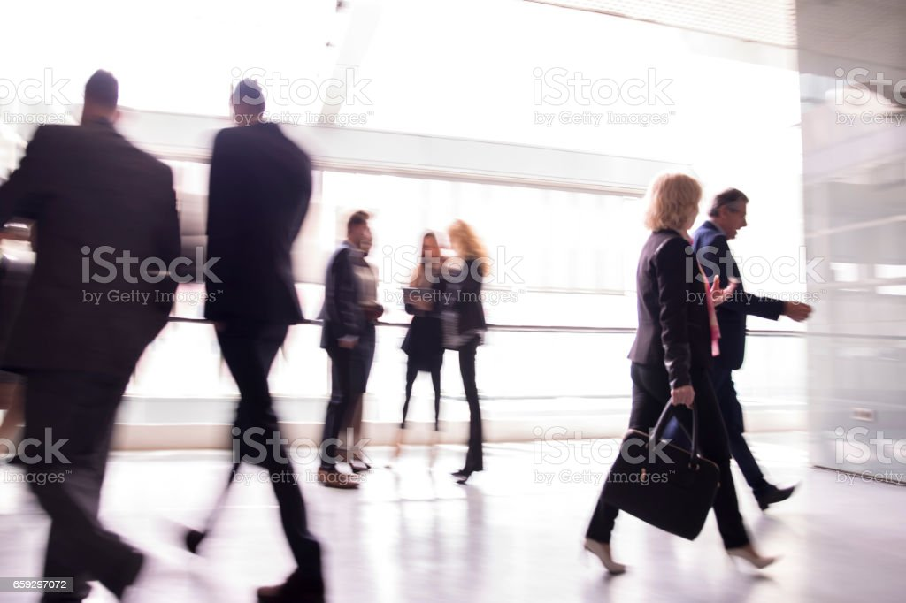 Business people walking down the hall stock photo
