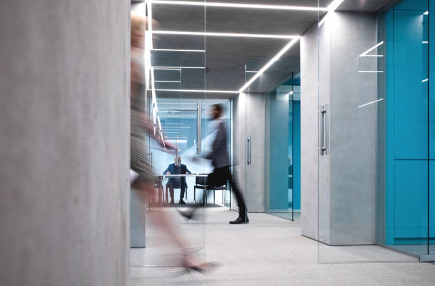 Business People Walking Down The Hallway stock photo