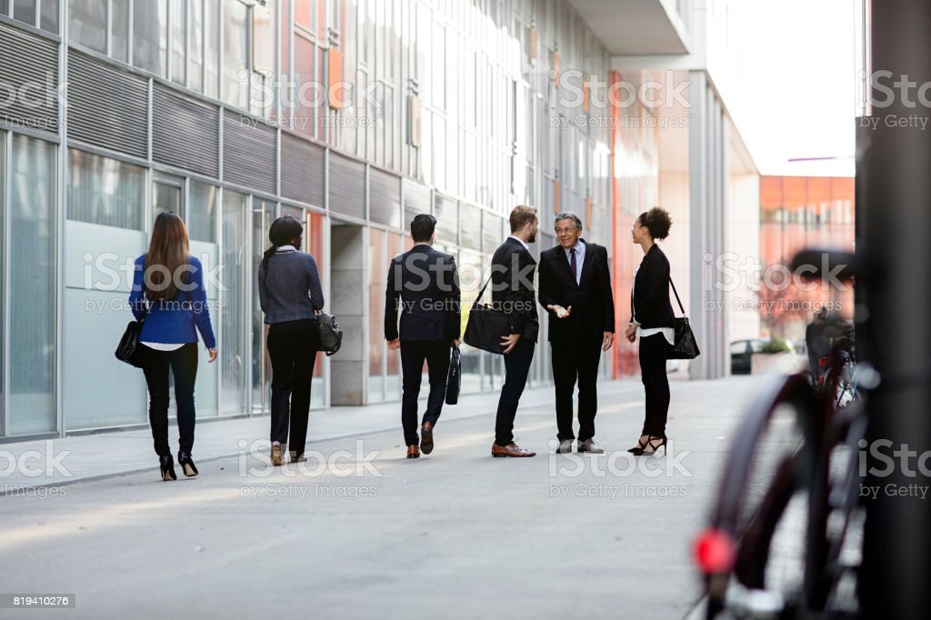 Business people walking downtown business district stock photo