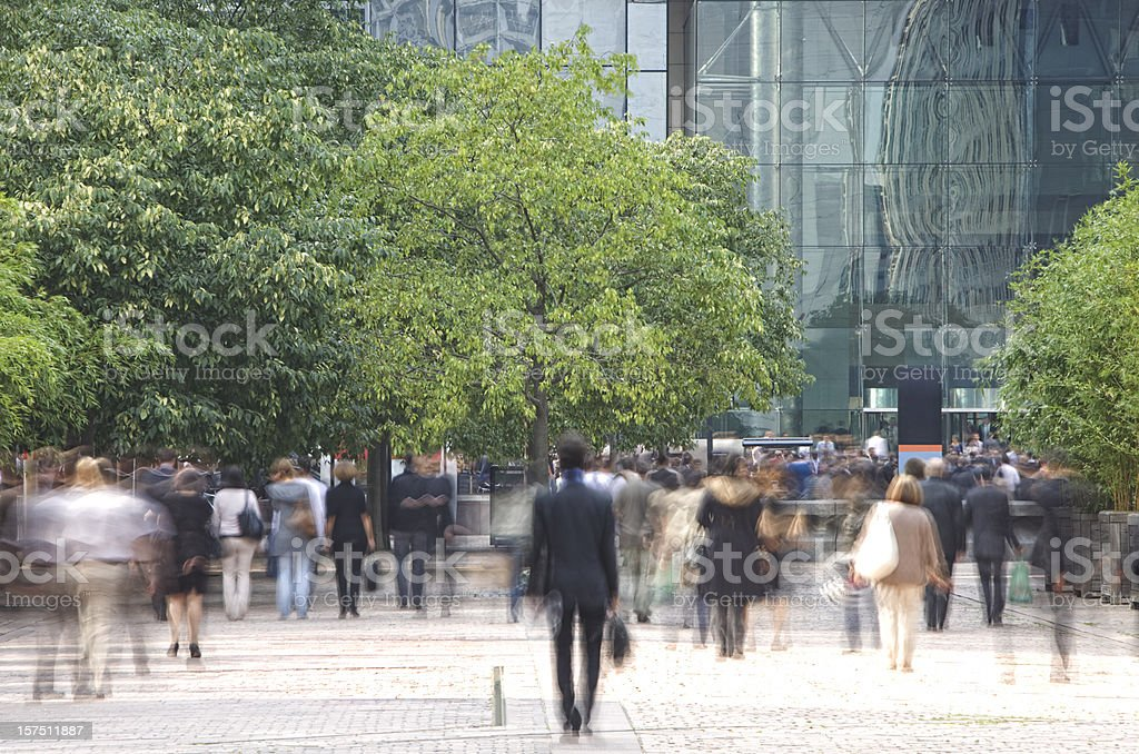 Business people walking in a financial district, blurred motion stock photo