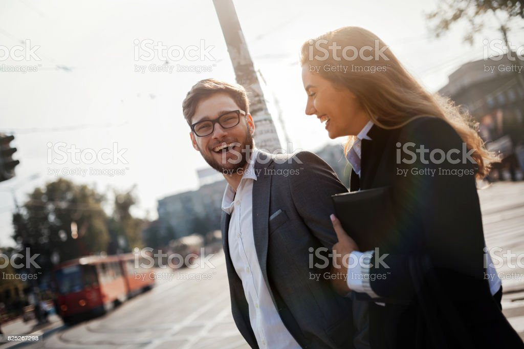 Business people walking in city stock photo