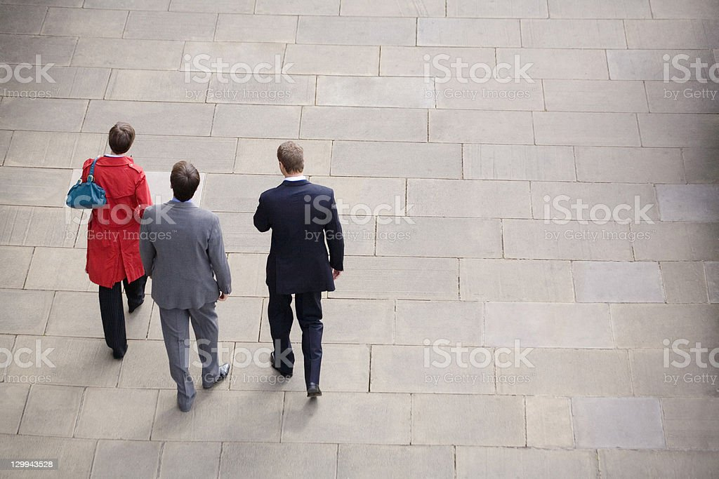 Business people walking in courtyard stock photo