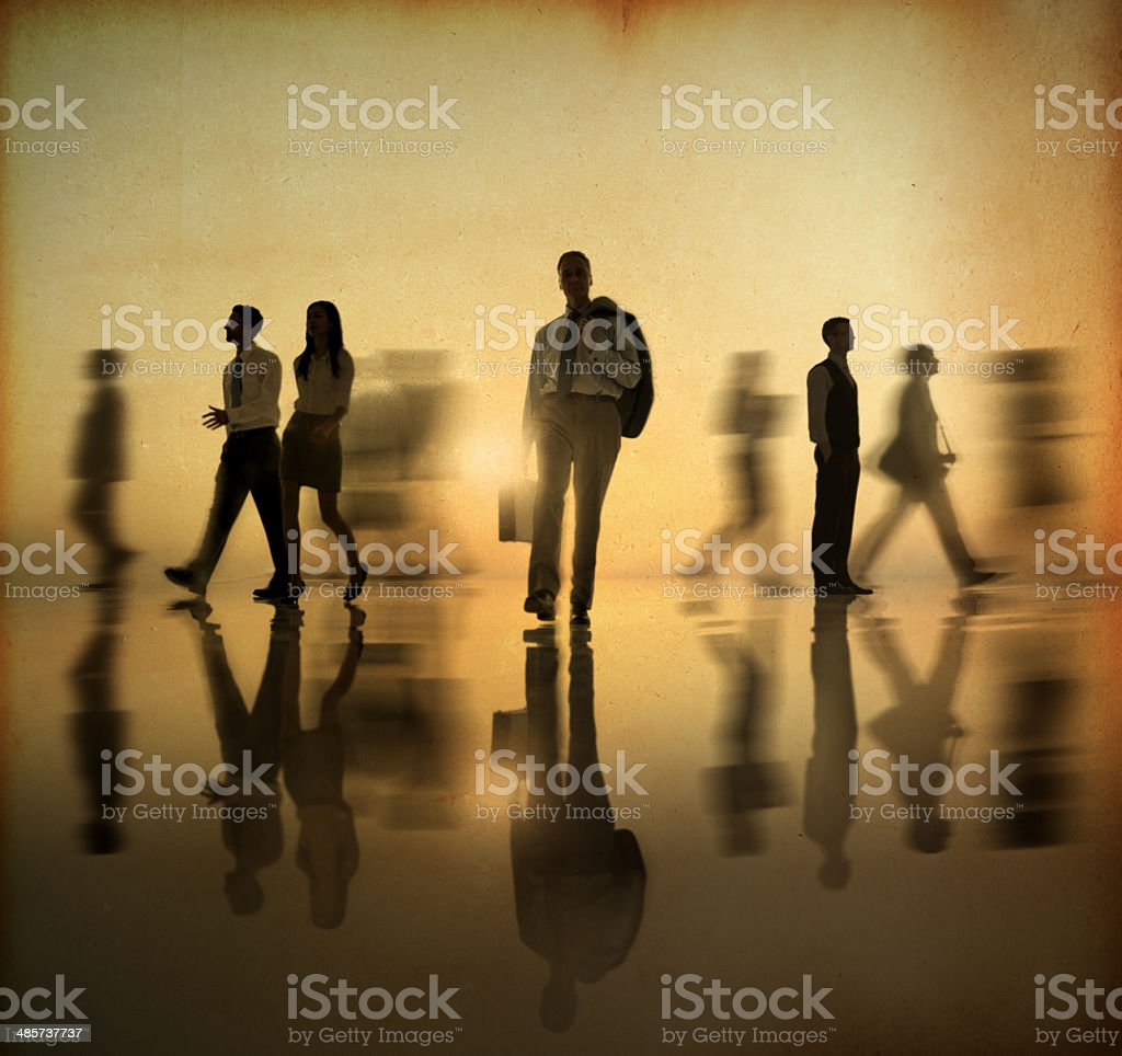 Business people walking in motion royalty-free stock photo