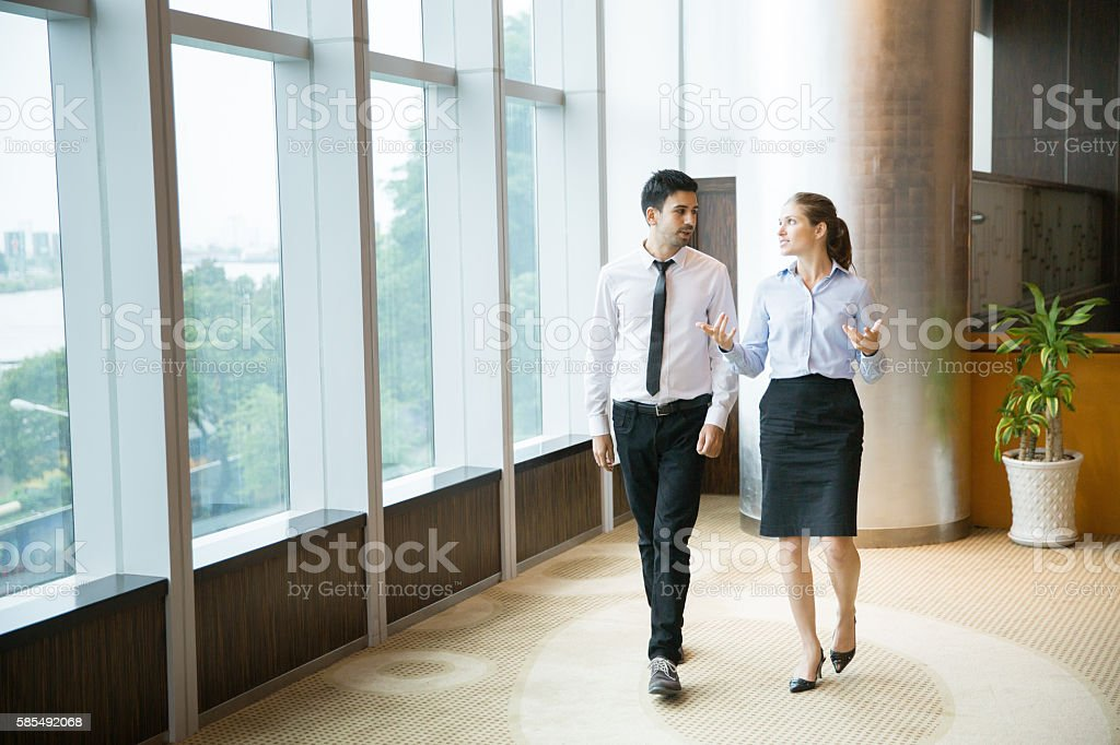 Business People Walking in Office 1 stock photo