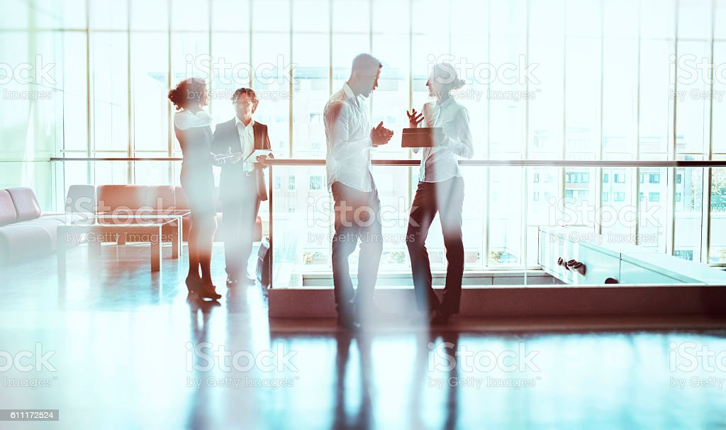 Business people walking in the office building lobby stock photo