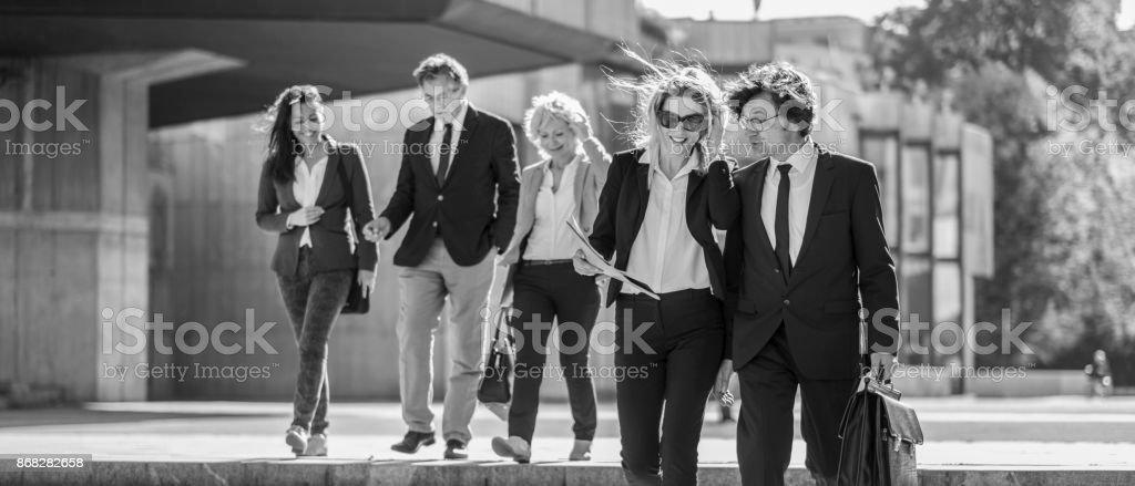 Business people walking in the street.